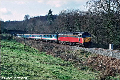 47703 'The Queen Mother' works the 1422 Exeter St Davids-London Waterloo at Cotleigh on 28/02/1992.