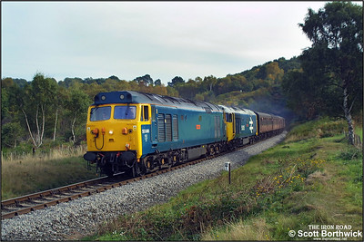 50049 'Defiance'+50035 'Ark Royal' emerge from Foley Park tunnel working the 1115 Kidderminster-Bridgnorth service on 04/10/2002 during the Severn Valley Railways Autumn Diesel Gala.
