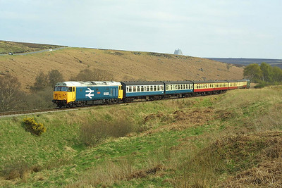 50033 heads the 1520 Pickering-Grosmont service at Moorgates on 24/04/2004. 50007 is on the rear.