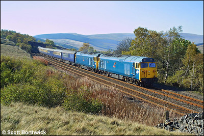 50049 'Defiance'+50031 'Hood' are photographed approaching Garsdale whilst working 1Z85 0600 Ashford-Carlisle on 18/10/2003.