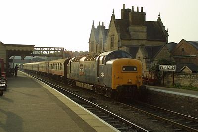55019 is seen in golden evening sunshine at Wansford on 13/10/2001.