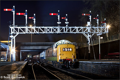 D9016 'Gordon Highlander' passes under the impressive signal gantry at Bury Bolton Street on 16/02/2013.