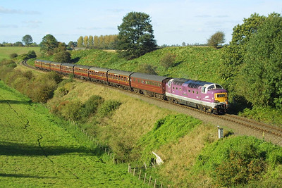 D9016 rolls downgrade on Eardington bank with the 1535 Bridgnorth-Kidderminster service on 04/10/2002.