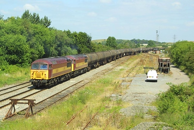 56065+56071 reverse their train into Kingsbury Oil Sdgs.