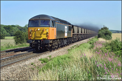 With coal dust flying, 56083 thunders past Elsham Carrs working 7C78 1448 Immingham Coal Terminal-Scunthorpe BSC CHP on 26/07/2002.