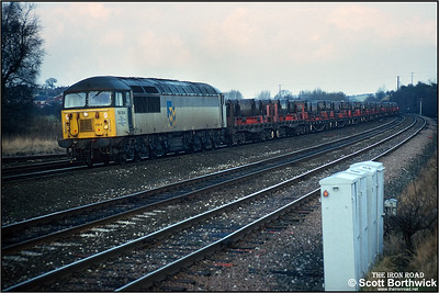 56064 works a train of steel coil south at Clay Cross Jnct on 01/02/1993.