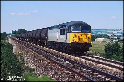 56007 thunders past Homedown LC, Ashchurch whilst in charge of 6V14 Hull Saltend-Baglan Bay 'vinegar tanks' on 27/07/2001.