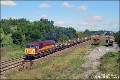 56060 passes Kingsbury Sdgs whilst working a southbound steel service on 04/09/2001.