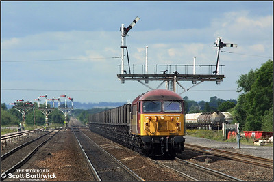 With a fine array of semaphore signals visible, 56091 approaches Barnetby station whilst working 6C72 0940 Scunthorpe BSC CHP-Immingham Coal Terminal on 27/06/2002.