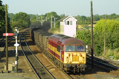 56060 passes Barnetby East siignal box bathed in evening sunshine on 26/07/2002 whilst working 7C80 1748 Immingham Coal Terminal-Scunthorpe BSC CHP.