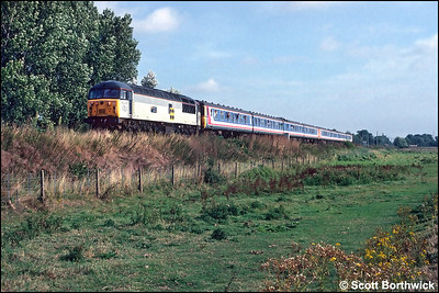 56012 'Maltby Colliery' hauls 312789+312790 forming 2G30 0930 Kings Lynn-Cambridge on 14/09/1991. The train was an additional working in connection with the Network South East 'Network Gala Day 1991'. Note the recently installed masts for the Kings Lynn line electrification scheme to the rear of the train.