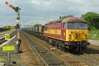 56091 thunders through Barnetby whilst working 6C72 0940 Scunthorpe BSC CHP-Immingham Coal Terminal on 27/06/2002.