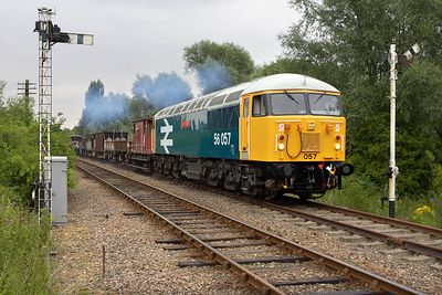 Pictured on its second run past at Orton Mere, 56057 comes off the Fletton branch on 22/07/2005.