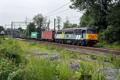 56301 passes Berkswell on 16/06/2006 whilst in charge of 4O90 1101 Doncaster Railport-Thamesport (Grain).