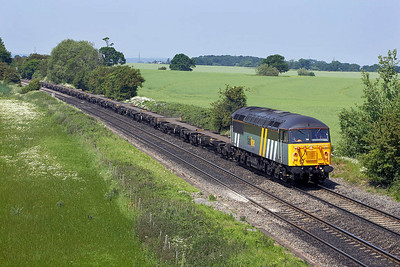 56302 powers the 'Fresh Air Express' running as 4090 1040 Doncaster Down Decoy-Thamesport through Portway on 09/06/2006. Loadings have been poor on the service to date but as Thamesport cannot handle dangerous goods by road (their conveyance must be by rail) we should see some containers eventually.
