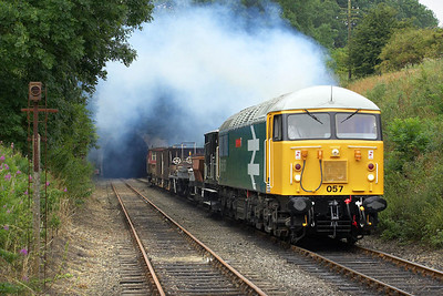 56057 lays down the clag as it passes through Wansford cutting on 22/07/2005 during its first run past of the day.