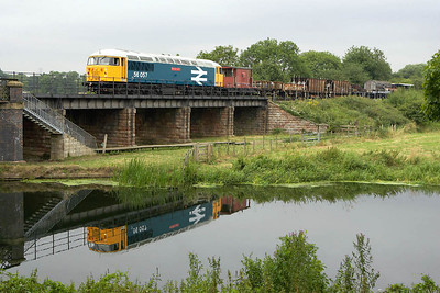 With a perfect reflection in the River Nene, 56057 is photographed awaiting entry to Wansford station at the end of the EMRPS photo charter of 22nd July 2005. £1038 was raised for the Nene Valley Railway, an additional £200 raised towards the cost of a new traction motor for 56057, and a collection for the crew raised £38 for them to have a drink on the EMRPS. A great day all round.