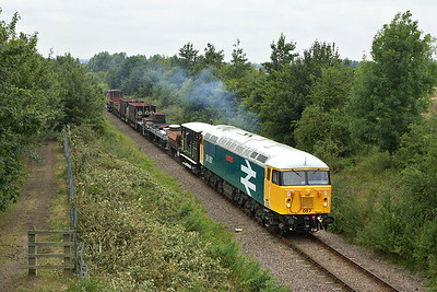 56057 is pictured at Mill Road, Castor during the EMRPS photo charter of 22/07/2005.