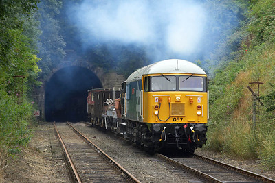 The characteristic exhaust of the class 56 is clearly visible in this photo of 56057 exiting Wansford Tunnel on 22/07/2005 on its second run past.