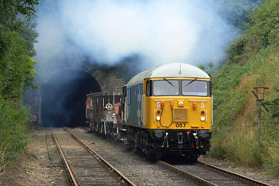 56057 storms out of the 617 yard long Wansford Tunnel on 22/07/2005 with its first run past of the day.