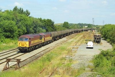 56065+56071 reverse their train into Kingsbury Oil Sdgs.