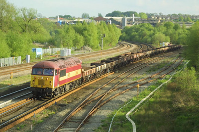 56062 slows to cross onto the relief lines at Clay Cross Junction on 08/05/2003 with 6E71 1504 Wolverhampton Steel Terminal-Roundwood (Aldwarke) empties.