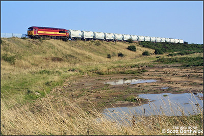 Approaching Lynemouth at Woodhorn, 56119 nears its destination with 6N69 1524 North Blyth-Lynemouth on 11/09/2002.
