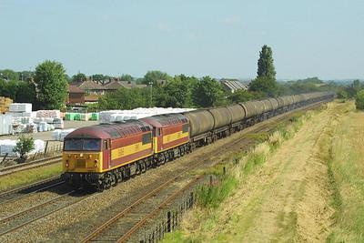 56065+56071 pass Wetmore Farm, Burton upon Trent with fuel tanks for Kingsbury Oil Sdgs.