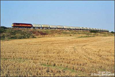 After exchanging its loaded wagons for a set of empties, 56119 departs from Lynemouth, seen here near Alcan Jnct at Woodhorn, with 6N32 1630 Lynemouth-North Blyth on 11/09/2002.
