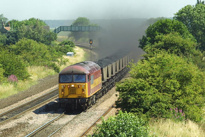 56060 speeds through Melton Ross on 26/07/2002 with 7C76 1220 Immingham Coal Terminal-Scunthorpe BSC CHP.