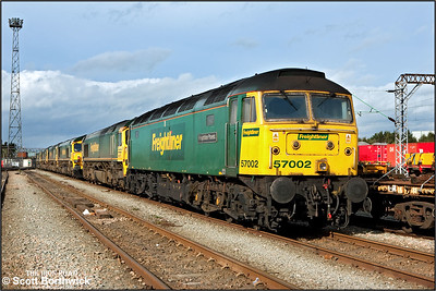 57002 'Freightliner Phoenix', heads a row of Freightliner 66's stabled at Crewe Basford Hall on 09/10/2005. (With permission).