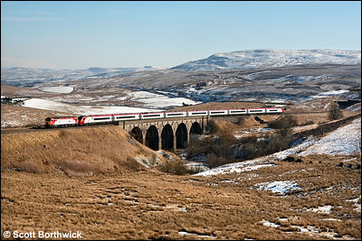 57306 'Jeff Tracy' drags 390013 northwards across Lunds viaduct on 04/03/2006 forming 1S40 0658 London Euston-Glasgow Central.