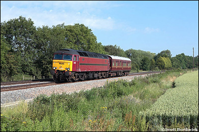 57601 with Saloon 6320 in tow passes Claydon Crossing on 29/06/2006 with 2Z01 0650 Stafford-Crewe via Acton Main Line.