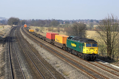 57001 hauls a very lightly loaded 4O29 0535 Trafford Park-Southampton MCT at Lower Basildon on 23/03/2006.