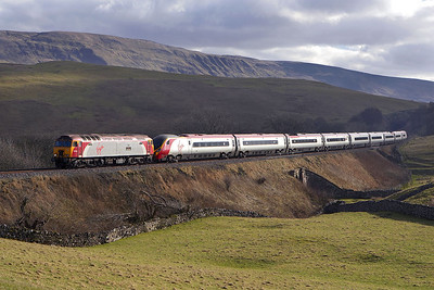 57303 'Alan Tracy' drags 390012 at Birkett Common on 18/02/2006 with 1S40 0715 London Euston-Glasgow Central.