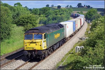 57008 passes Holmes House Farm near Bishops Itchington with 4O14 0432 Garston-Southampton MCT on 19/06/2003.