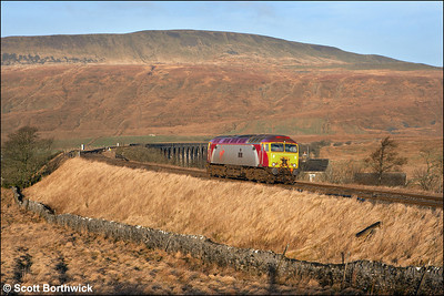 57311 'Parker' heads north in gorgeous morning sunshine at Ribblehead on 21/06/2006 whilst running as 0Z10 0744 Preston-Kirkby Stephen. Upon arrival the loco would act as the S&C 'Thunderbird' for the day in case any problems arose during the WCML diversions.