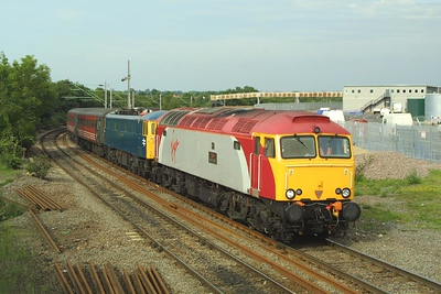 57303 drags 87001 past Nuneaton Abbey Jnct on 07/06/2003 with a diverted 1G35 1550 London Euston-Wolverhampton.