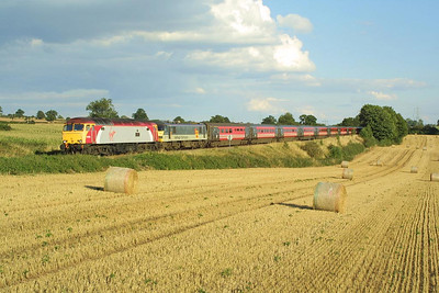 In a lovely late Summer scene at Daw Mill, 57305 drags 90021 and its train 1G35 1700 Northampton-Wolverhampton on 30/8/2003.