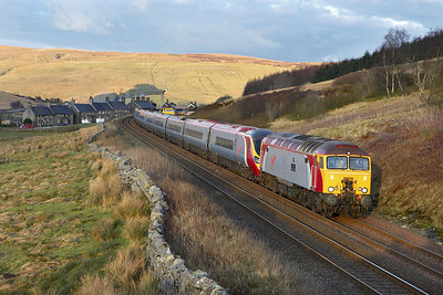 57304 'Gordon Tracy' drags 390006 catching the last rays of evening sunlight at Garsdale on 18/02/2006 whilst working 1M18 1349 Glasgow Central-London Euston.