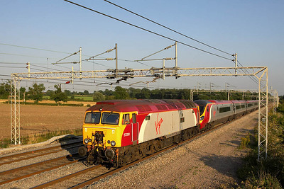 57310 drags an errant 390015 forming 1S82 1645 London Euston-Edinburgh Waverley at Easenhall on 17/08/2005. The Pendolino was suffering from AWS failure so 57010 was attached at Rugby. However, all was not well with the Thunderbird as it ground to a halt at Cathiron. After a 15 minute stand it is seen staggering northwards. Use was made of the bi-directional 'Up Main' to allow trains to pass. The train was later terminated at Preston having lost another 55 minutes en route with the 57 being low on power. Thanks to Mark Bearton for assistance with the train ID and other info.