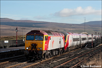 57306 'Geoff Tracy' drags 390037 forming 1S40 0715 London Euston-Glasgow Central through Ribblehead on 21/01/2006.