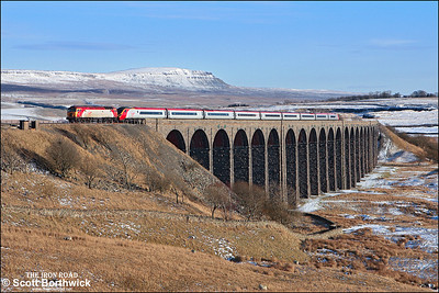 57307 'Lady Penelope' drags 390047 off Ribblehead viaduct whilst forming 1S56 1100 London Euston-Glasgow Central on 04/03/2006.