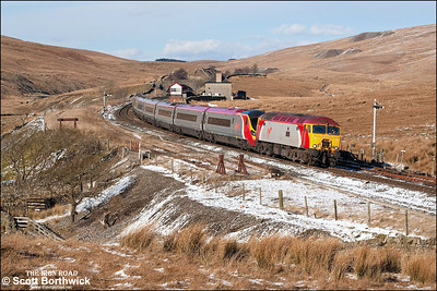 57314 'Firefly' drags 390038 across Blea Moor whilst working 1M16 1140 Glasgow Central-London Euston on 04/03/2006 .