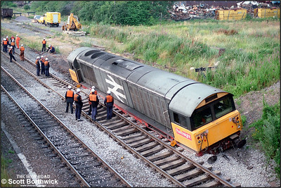 Having run away from Birch Coppice colliery and eventually derailling alongside the Derby-Birmingham mainline at Kingsbury, 58013 is well and truly 'in the dirt' on 06/08/1987. Here the aftermath of the derailment is evident as numerous workers prepare for a busy night ahead.
