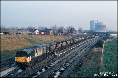 58003 'Markham Colliery' sets back into the sidings at Three Spires Junction, Coventry with a rake of empty HAA hoppers on 20/02/1992.