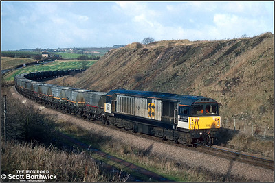 58018 'High Marnham Power Station' passes Hall Lane Jnct on 19/11/1992 with a train of HAA 'merry go round' coal hoppers from the Barrow Hill direction for reloading at Oxcroft Opencast Disposal Point. This line is now closed and track lifted.