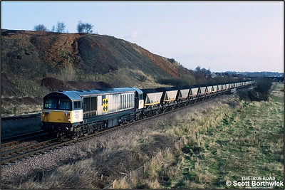 58024 passes Hall Lane Jnct and heads towards Barrow Hill with a 'merry go round' coal train from Oxcroft Opencast Disposal Point on 19/11/1992. The lines are now closed and track lifted.