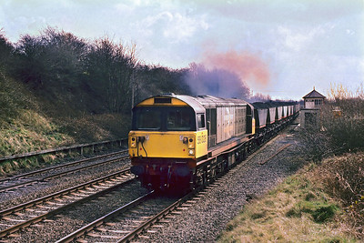 58028 powers past Moira West Jnct with 7G23 1135 Coalville Mantle Lane TC-Rugeley CEGB on 30/03/1988.