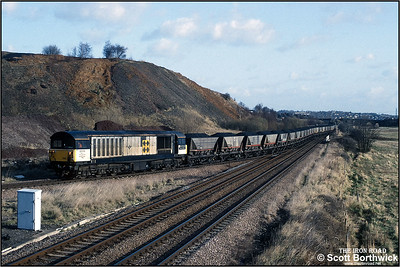 58024 passes Hall Lane Jnct and heads towards Foxhall Jnct  with a 'merry go round' coal train from Oxcroft Opencast Disposal Point to Cottam Power Stationson 19/11/1992. The locomotive would need to run round at Woodhouse Jnct in order to be able to gain the line through to Worksop. The lines are now closed and track lifted.